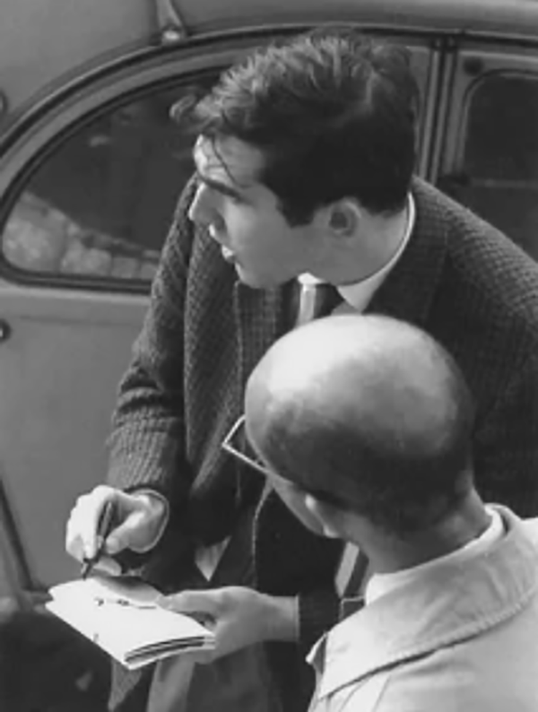 Figure 4. Stanley Brouwn (foreground) and a collaborator in the 1960s.