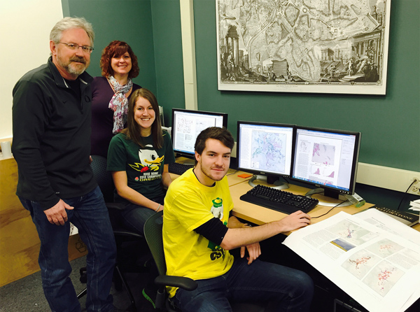Figure 4. Jim Meacham, Alethea Steingisser, and students Lauren Tierney and Riley Champine work on the Atlas of Wildlife Migration: Wyoming's Ungulates.