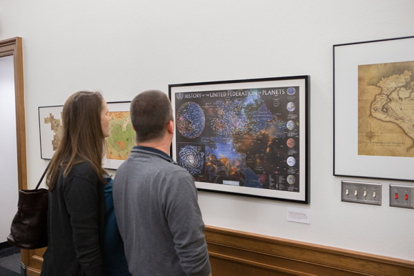 Figure 4. Exhibit attendees viewing the United Federation of Planets map.